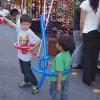 The Old Town La Verne Family Festival and Farmers Market resumed March 31. Fresh produce, crafts, children's rides, food and entertainment brought patrons from La Verne and surrounding cities to enjoy the festivities. La Verne residents, brothers Michael and Robbie Burlace, battle with their balloon swords while their parents look at new tile. The Farmers Market will continue through the summer every Thursday on D Street from 5:30 p.m. to 9 p.m.//Victoria Castaneda