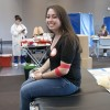 Junior Christina Mirzayan donates blood at the American Red Cross blood drive on April 6 in the Campus Center Ballroom. Despite feeling queasy afterward, Mirzayan said that donating blood was worth the effort because it was for a good cause. / photo by Victoria Castaneda