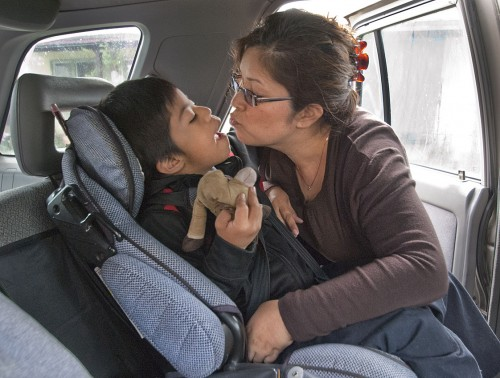Joanne Avery often lets her son Jake, who has Down syndrome, take his favorite toy, Bullseye, in the car to keep him from distracting her while driving.