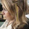 Stephanie Sommers, an employee at Primped Salon & Boutique located on Foothill Boulevard, got a feather extension added to her collection. The salon, owned by Joy Campbell, offers new hairstyles, perms, supplies and even clamp-in feather extensions. The feather extentions come in a variety of shapes and sizes starting at $5 each./Brittney Slater-Shew