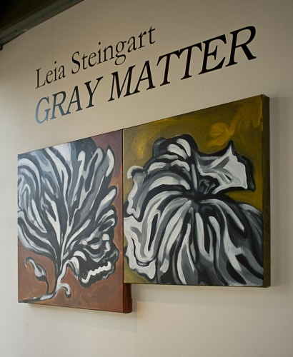 "The paintings in Leia Steingart's recent ""Gray Matter"" exhibit at the Bunny Gunner Gallery in Pomona illustrated her transition from the black and white clarity of childhood to the gray areas of adulthood, with flowers and faces. The gallery's current show, featuring Stan Welsh, runs through Oct. 4. / photo by Mitchell Aleman"