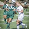 During the second half of the overtime period in the women's soccer game against UC Santa Cruz on Sunday, sophomore midfielder Christine Camacho fights to keep possession against Santa Cruz's freshman defender Amanda Cameron. Backing her up is junior defensive midfielder Kristina Roche. The Leopards had many opportunities to attack the Banana Slugs' goal, but the game ended in a scoreless tie, the Leopards' third of 10 games this season. / photo by Zachary Horton