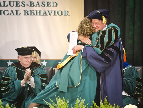 After being sworn in, President Devorah Lieberman is congratulated by former La Verne President Steve Morgan. To the left, Richard Guarasci, president of Wagner College, adds his appreciation. / photo by Zachary Horton
