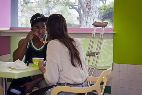 Freshman art major Keoni Colson shares a frozen treat with Ariel Le at Granny's Yogurt on Monday. Granny's Yogurt, located on the corner of D and Third streets in downtown La Verne, offers a large variety of yogurt flavors and toppings. Customers serve themselves and pay by the ounce. In addition, the store offers boba teas, smoothies and cold drinks. / photo by Scott Mirimanian