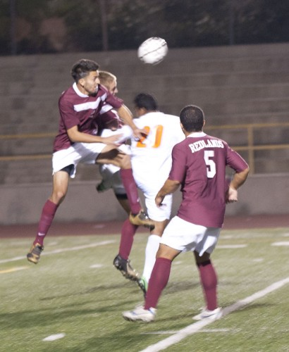 The men's soccer team went head-to-head with Redlands on Saturday. During the second half Bulldog sophomore defender Richie Marquez strikes a header with freshman midfielder Nico Johnson (No. 5) as his backup. Leopard sophomore forward Abdullah Alharshan is involved in the play, trying to stop Marquez. The Leopards were shut out by the visiting Bulldogs 3-0, who won the regular season Southern California Intercollegiate Athletic Conference championship for the second consecutive year. La Verne finished their season with a 6-9-1 overall record and 5-8-1 in conference play, good for fifth place overall. / photo by Denisse Leung