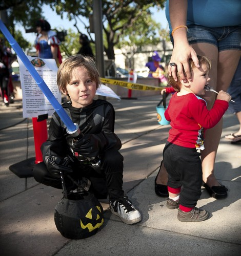 Cousins Parker (Darth Vader) and Will (dressed in a Cars Shirt), were brought to La Verne's annual Trick or Treat Festival by their grandmother, Sheryl Roy. Roy said they have attended this event for the past four years. Employees in the shops of downtown La Verne hand out candy to children in costume to celebrate the event. / photo by Cameron Barr