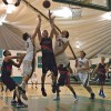 La Verne senior forward Jonathon Bastos narrowly outreaches fellow Leopard guard Jeremy Lay and Afghanistan National Basketball player Mostafa Asefi for the rebound on Saturday in Frantz Athletic Court. The Afghani team narrowly defeated the Leopards 63-61 after trailing in the first half 35-24. The Afghanistan National Team, coached by Mamo Rafiq, is comprised of first generation Americans born to Afghani immigrants. / Warren Bessant