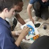 Junior organizational management major Sean Kelly, senior movement and sports science major DeAntwann Johnson and senior speech communications major Connor Eckert share their creativity through painting their partners' eyes in the Art Collective. / Brittney Slater-Shew