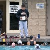 During their final week of practice before the first preseason games, head coach Alex La and assistant coach Cody Bell call the women's water polo team together to discuss the plays. The team will open its season with two back-to-back games Saturday at Las Flores Park in La Verne against Concordia, at 9 a.m. and Claremont-Mudd-Scripps at 11:30 a.m. / photo by Katherine Careaga