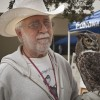 San Dimas Wild Wings volunteer Bruce Thoman helps visitors learn more about 22-year-old Andrew, a great horned owl, at the Family Bird Fest at the Rancho Santa Ana Botanic Garden in Claremont on Sunday. San Dimas Wild Wings is a nonprofit rehabilitation center for sick and injured native birds. See story on page 6.