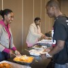Child development major Deveeda Smith serves macaroni and cheese to criminology major Myron Woods at the BSU Soul Food Luncheon on Tuesday in the Campus Center. Sociology and liberal studies major Lynesha Williams, BSU president, also served food./photo by Cassandra Egan