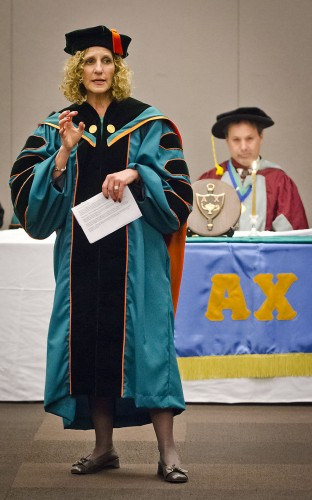 President Devorah Lieberman addresses the 102 Alpha Chi National Honor Society inductees on Tuesday in the Campus Center Ballroom. Behind her is Professor of English Jeffrey Kahan, who read each inductee's name. Membership to Alpha Chi is limited to the top 10 percent of the University's junior and senior classes. / photo by Zachary Horton