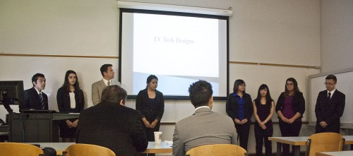 Students in the Integrated Business Program, who operate the company LVTech Designs, make new product presentation in the Landis Academic Center on Tuesday. The group – which includes Jonathon Agee, Brenda Perez, Raul Rodriguez, Karina Balmaceda, Blanca Mireles, Alicia Chhan, Brianna Martinelli and Jonathan Truong – pitched a University-themed laptop sleeve to Wells Fargo Bank Vice President Norm Liversidge and Assistant Vice President James H. Do. Based on the presentation, Wells Fargo gave the team a $5,000 loan to start their business. All profits from the sale of the laptop sleeves will go to the LeRoy Haynes Center, a local charity that helps children with special needs. / photo by Brittney Slater-Shew