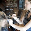 Julie Heuring from San Diego stops by Roots Hair Salon, which was opened by Amanda Clarke in January, to get her roots touched up. Heuring has been a customer of Heather Repee's for over two years, and Repee has been styling hair for more than 10 years. Roots also offers a braid bar at the La Verne farmer's market every Thursday night. / photo by Candice Salazar