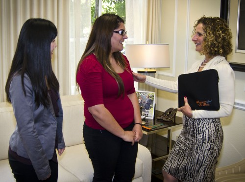 Sophomore Alicia Chhan and senior Brianna Martinelli, both business majors, present a University of La Verne laptop sleeve as a gift to President Devorah Lieberman in her Founders Hall office Wednesday. Chhan and Martinelli help run LV Tech Designs, a student organized company selling neoprene laptop sleeves. Chhan is manager of inventory and logistics; Martinelli is the vice president of public relations. / photo by Zachary Horton