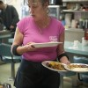 "Ramona Shuemate, who goes by ""Ramona From Pomona,"" serves up plates of eggs, hash browns and sausage. Ramona has worked at Roberta's Village Inn on D Street for more than 15 years. Francisco Ramirez, who worked at the restaurant as a cook for more than 12 years, bought the café in 2010. Roberta's is popular for breakfast and for pot roast./photo by Candice Salazar"