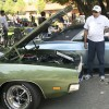 Louie Gonzales (left) showed his 1969 Dodge Charger R/T at the annual Cool Cruise 2012 Car Show on Saturday in Old Town La Verne. Gonzales purchased the car in 1968 and has cared for it ever since. The car show invaded the streets of Old Town with over 400 participants, and many more spectators, who enjoyed fresh food, friendly people, classic cars and hot rods. Cool Cruise was originally proposed to the city of La Verne in 2000 and has been a staple of the area ever since. / photo by Mitchell Aleman