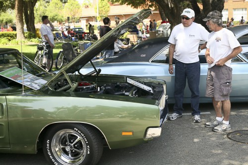 Louie Gonzales (left) shows his 1969 Dodge Charger R/T at the annual Cool Cruise 2012 Car Show on Saturday in Old Town La Verne. Gonzales purchased the car in 1968 and has cared for it ever since. The car show invaded the streets of Old Town with over 400 participants, and many more spectators, who enjoyed fresh food, friendly people, classic cars and hot rods. Cool Cruise was originally proposed to the city of La Verne in 2000 and has been a staple of the area ever since. / photo by Mitchell Aleman