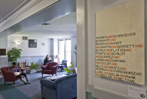 Dania Sayvongsa, an accounting major, has installed her art throughout Miller Hall, Campus Center and the Coffeeberry across the street from the University. The art will remain up until May 11, excluding those displayed in Campus Center that will remain there on a permanent basis. The artwork in the foreground includes the names of department chairs at the University. / photo by Cameron Barr