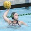 Freshman driver Kelsey Broyles passes the ball during the women's water polo team's 15-6 loss to Occidental on Saturday at the La Verne Aquatics Center. She also scored a goal in the game. / photo by Debora Escobar