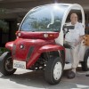 "Leroy Lapp (left), who graduated from La Verne College in 1953, showcased his global electric car ""Ruby"" to Shawn Kirchner, La Verne Church of the Brethren's instrumental music coordinator, at the Earth Day Home Energy Fair at the La Verne Church of the Brethren on Sunday. Lapp also helped plan the event that focused on ways to save money and energy at home./photo by Cassandra Egan"