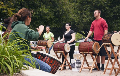 La Verne students Lauren Medina, Alondra Hernandez, Heather Bland, and Christian Winnewisser play an impromptu concert in Sneaky Park on April 25. Steve Biondo's West African Drumming class practiced outdoors in preparation for its upcoming concerts May 5 at the Church of the Brethren and May 16 in Morgan Auditorium. /photo by Scott Mirimanian