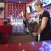 Amanda Patron and Ana Ivanova work as servers and bartenders at Old Town La Verne's new restaurant, House of Wings Sportsbar, which opened April 7. In the spot that was once home to Ellsworths' Stationers, the restaurant features a full bar and an extensive list of beer on tap and in bottles. House of Wings features two happy hours, the first from 3 p.m. to 6 p.m. and the second from 10 p.m. to closing./photo by Brittney Slater-Shew