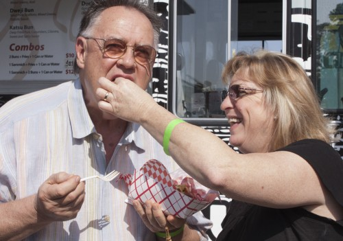 Susan and Scot Howard enjoyed a zucchini tornado from the My Tornado Potato food truck at Damien High School's Food TruckFestival on Sunday. The event featured 20 trucks with many different types of food as well as live music, such as Mad-n-Mack from Alta Loma. Damien held the festival to raise money for their athletic facility and hopes to make it an annual event. / photo by Cassandra Egan