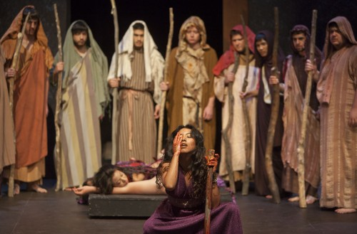 "Clytemnestra, played by junior theater arts major Stephanie Aguilar, boasts of the murders of her husband Agamemnon and Cassandra, played by Cody Goss and Lauren Ervin, during the dress rehearsal for ""The House of Atreus."" Directed by Georgij Paro, the play is modified from the script originally written by the Greek playwright Aeschylus, who is known as the ""Father of Tragedy."" / photo by Christian Uriarte"