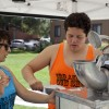 Cindy Vallejo, junior communications major, and Spencer Contreras, junior business administration major, prepare free snow cones for students at the University of La Verne's third annual Soakfest on May 10 at the University Mall. In addition to giving out free french fries, snow cones and tank tops, the event also had a DJ and a variety of water activities./photo by Christian Uriarte