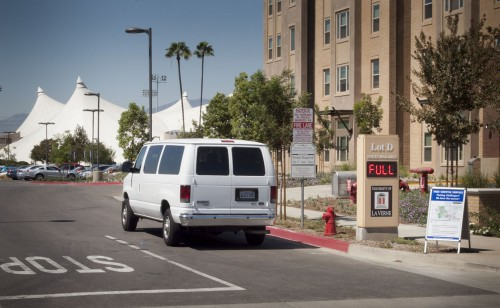 With the limited number of parking spots available on the University of La Verne campus and a historically high 2,500 students, this free shuttle takes some students, faculty and staff to a remote parking lot on A Street, south of Arrow Highway. The remote lot has 332 spaces. The shuttles stops at the northeast corner of parking lot D. / photo by Katherine Careaga