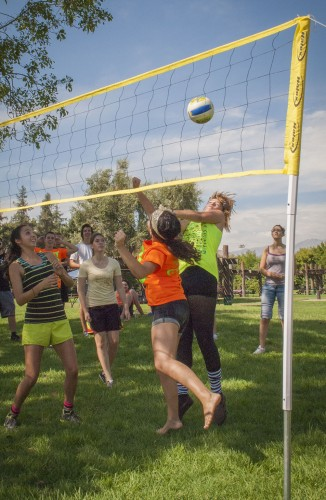 Elizabeth Loera, Marisol Martinez, Brittany Martinez, Jessica Loomer and Sarah Mayo play on a team together in the Iota Delta Sorority 1980s volleyball tournament Saturday at Las Flores Park. The objective was to raise money for their Kimberly Tuers Iota Delta scholarship. Students could create a team to compete in the tournament for $2 a player. / photo by Kelley Maggiulli