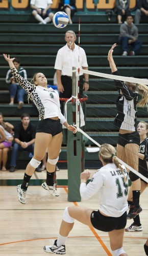 Senior middle blocker Kayla Cribbs rockets the ball over the net for one of her five kills in the final set of Tuesday's match against Chapman at the Frantz Athletic Court. La Verne defeated the No. 1 ranked Panthers in a grueling five-set match to move into a second place tie in the Southern California Intercollegiate Athletic Conference. / photo by Hunter Cole