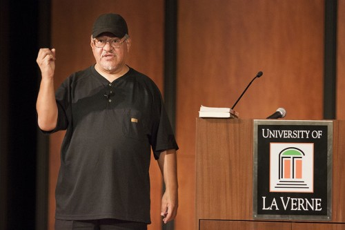 """Luis Rodriguez, author of """"It Calls You Back,"""" talked about how he learned from his mistakes and overcame obstacles during his lecture Oct. 4 inMorgan Auditorium. Rodriquez's book, """"It Calls You Back,"""" is the One Book, One University choice for the freshman class this year. / photo by Pablo Cabrera"""