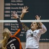 During Saturday night's game against Occidental, senior middle blocker Kayla Cribbs defends her side of the net from junior middle blocker Aly Fritz. The Leopards outran the Tigers in three sets at Frantz Athletic Court and improve their overall record to 16-2 and 9-1 in SCIAC. / photo by Zachary Horton