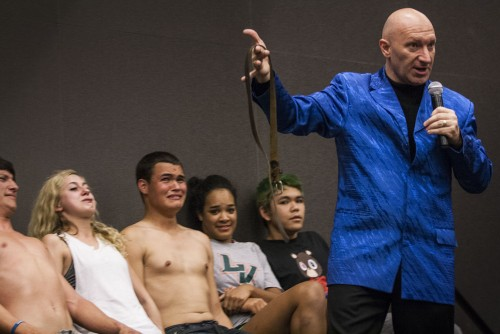 Hypnotist Mark Maverick found his way to the University of La Verne for one of the events sponsored by the Campus Activities Board. Freshman Paul Clark, freshman Ashlyn Cross, freshman Andrew Perotti, freshman Destinee Sales and sophomore Eldric Rabago were among the 14 students that were hypnotized. At one point during the event, the hypnotized students were told to imagine an animal that scared them and told that the belt was the animal that they were imagining. / photo by Ryan Gann