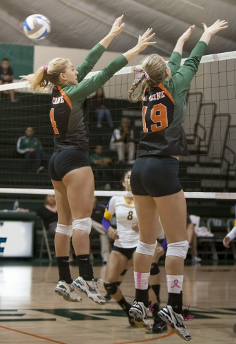 Kayla Cribbs (left) and Nysa Allen (right) try to block Cal Lutheran's attack in the second set of Tuesday's match. The Leopards lost the first set, 27-25, then the second set, 25-20, and the third set, 25-16. This is the Leopards' second loss to Cal Lutheran this season. The two teams were tied for second place in the conference going into the match, but with a 3-0 loss, La Verne dropped to third place, leaving Cal Lutheran alone in second. / photo by Jessica Harsen