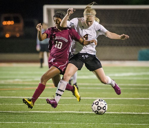 La Verne junior defender Sarah Ruden cuts off Redlands junior forward Lihini Weerasinghe to keep possession of the ball Saturday night at Ortmayer Stadium. The game had two overtime periods and still ended in a draw, 0-0. The women are now 1-10-2 in SCIAC play. / photo by Zachary Horton