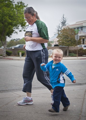 John Durant, son of strength and conditioning coach Matt Durant, and his grandmother Cindy Haaker participate in the 5K Fun Run/Walk hosted by the La Verne Athletic Training Student Club. The 5K was part of the several activities held on Saturday, leading up to the Homecoming football game against Pomona-Pitzer. / photo by Katherine Careaga