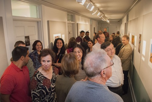 """The Carlson Gallery hosts a well-attended reception for the photographers and writers in the most recent exhibition, """"Dissent,"""" on Nov. 2. Gallery guests included Isela Peña-Rager and Raffi Zinzalian, two of the alumni photographers whose work was being shown. Alpha Chi co-sponsored the reception with the photography department and the writing program. / photo by Kelley Maggiulli"""