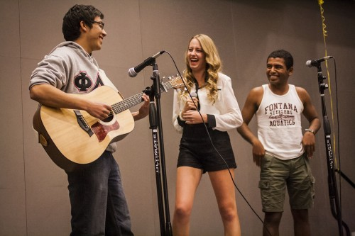"Sophomores Eric Torres, Kayla Hockman and Juan Mejia Semental perform the song ""Everything Has Changed"" by Taylor Swift at the Phi Sigma Sigma and Latino Student Forum talent show Nov. 14 in the Campus Center. For the last five years, the Phi Sigma Sigma sorority and the Latino Student Forum put on a talent show as a fundraiser. Half of the proceeds go towards the Neddie Memorial scholarship and the other half goes to LSF. / photo by Ryan Gann"