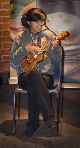 Freshman communications major Sommer Garcia plays the ukulele at the Winter Wonderland Talent Show last week in Davenport Dining Hall. The purpose of the event was to introduce residents to their faculty fellows, who are assigned to mentor the residents in the different residence halls. / photo by Kelley Maggiulli