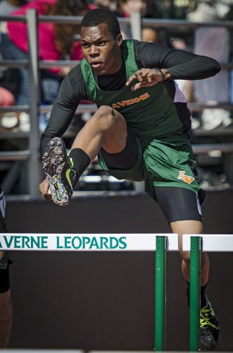 Junior James Francis races to win his heat of the 110-meter hurdles during the La Verne Invitational meet Saturday at Ortmayer Stadium. Francis finished second with a time of 16.31. / photo by Zachary Horton