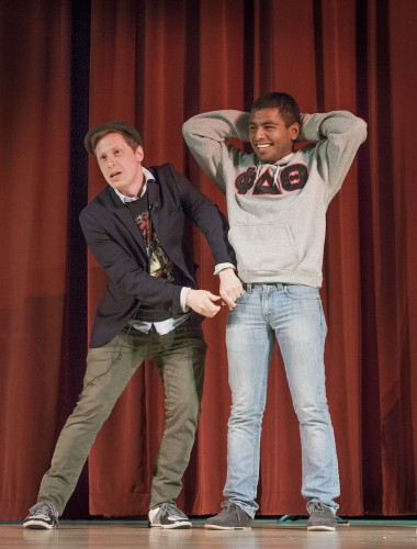 At CAB's event on Tuesday sophomore criminology and psychology major Juan Mejia-Simental is pickpocketed by magician Ben Seidman on stage in the Morgan Auditorium. Seidman has been practicing magic since age 6 and grew up in Milwaukee, where he attended the University of Wisconsin. He finished his senior year at the University of Nevada, Las Vegas, to study with other magicians. / photo by Stephanie Ball