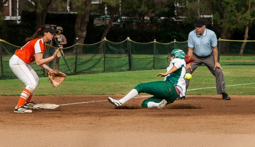 Junior first basemen Raven Freret slides into third base toward Occidental's senior pitcher Brittnay Vacura during Saturday's doubleheader. The teams split the doubleheader, leaving La Verne to win the first game, 1-0, and Occidental the second, 2-1. / photo by Chelsea Knight