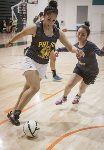 Junior psychology major Brianna Romero defends the ball from freshman health science major Jackie Selva at Phi Sigma Sigma's Kicks for Kidneys event March 7 at the Frantz Athletic Court. The money raised will go to the Phi Sigma Sigma foundation, which benefits the National Kidney Foundation. / photo by Stephanie Ball