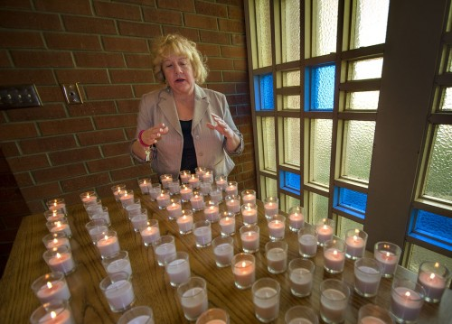 Leslie Ann Young, professor of education, lit candles at the altar in Dant Chapel Wednesday to symbolize unity among all people. The candle lighting, organized by the University's Gay-Straight Alliance, was organized to bring attention to the issue of gay marriage and the current U.S. Supreme Court deliberations over California's Proposition 8, which made gay marriage illegal, and the federal Defense of Marriage Act. The Court's decision is expected in June. / photo by Mitchell Aleman