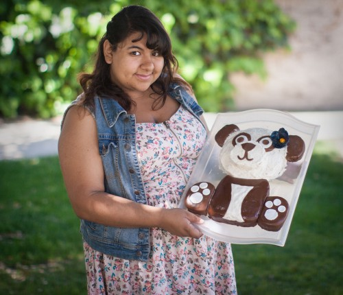 Gabrielle Alarcon, sophomore psychology major, has been baking with her mother since she was a child. Alarcon started to experiment with baking on her own in middle school. This vanilla chai tea cake, featuring honey cream frosting, was Alarcon's first time using fondant, a hard form of frosting that is easily formed into shapes. / photo by Nicole Ambrose