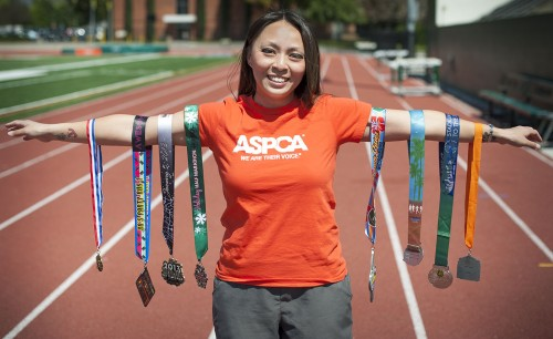 Information Systems Specialist Melissa Lau spends her weekdays working in the financial aid office, but on the weekends she is either running a race or training for one. Her first goal, to run in 31 races before she turned 31, was accomplished when she finished the Los Angeles Marathon on March 17. She is currently looking to her next goal, which includes a race in October in which she will run for the American Society for the Prevention of Cruelty to Animals. / photo by Hunter Cole