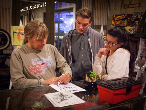 Artist Wade Stanley demonstrates different ideas for a painting with Nolan Moore and Miranda Munoz at the Claremont Art Walk Friday. The event occurs the first Friday of each month at the Claremont Packing House in downtown Claremont and features a range of local artists. / photo by Chelsea Knight